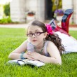 Young Hispanic Girl Reading Outside — Stockfoto