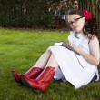 Young Hispanic Girl Reads Under Tree — ストック写真