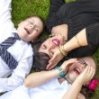 Mother, Son, and Daughter Lauging Outside in the Grass — Stok fotoğraf