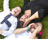 Mother, Son, and Daughter Lauging Outside in the Grass — Photo