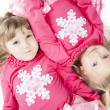 Stock Photo: Sisters in Matching Winter Outfits