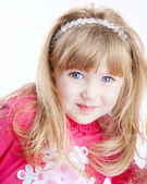 Little girl with big blue eyes looking at camera — Stockfoto