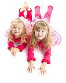 Two sisters laying down smiling — Foto Stock