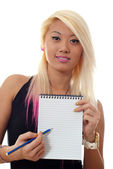 Woman holding notepad — Stock Photo