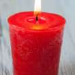 Stock Photo: Red burning candle