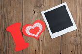 Instant photo and paper letter with hearts — Stock Photo