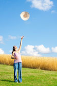 Throwing hat up in sky — Stock Photo