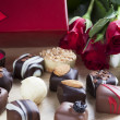 Chocolates and Red Roses — Stock Photo