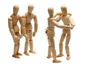 Dancing wooden dolls on party — Stock Photo