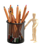 Wooden doll with pencils in garbion cage — Foto de Stock