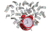 Alarmclock with flying dollars — Stock Photo