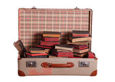 Suitcase stuffed with books — Stock Photo