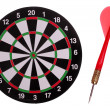 Dart board with red arrow — Stock fotografie #24573437