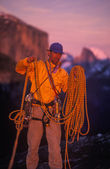 Climber coiling ropes. — Stock Photo