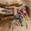 Stock Photo: Female climber gripping rock.