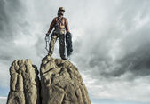 Climber on the summit. — Stock Photo
