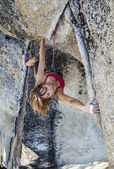 Female climber on the edge. — Stock Photo