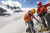 Climbing team rappelling. — Stock Photo