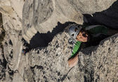 Climber scales a cliff. — Stock Photo