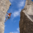 Climber struggles up a cliff. — Stock Photo