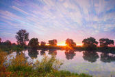 Landscape sunset on the river — Stock Photo