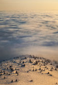 Peaks above clouds — Stock Photo