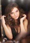 Beautiful brunette in dressing room. — Stock Photo