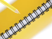 Yellow pencil and notepad — Foto Stock