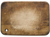 Used wooden cutting board — Stock Photo