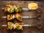 Barbecued chicken skewer — Stock Photo