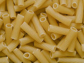 Uncooked maccheroni pasta tubes food texture background — Stok fotoğraf