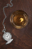 Silver pocket watch and a glass of whiskey — Stock Photo