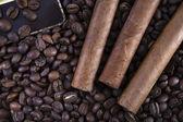 Three cigar on coffee beans — Stock fotografie