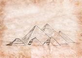 Drawed Egypt pyramids on grunge background — Stock fotografie