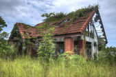 Old ruins of broken house with HDR effect — Stockfoto