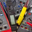 Detail of different portable multimeters - Stock Photo