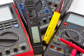 Detail of different portable multimeters — Stock Photo