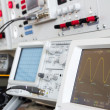 Digital and analog oscilloscope in the foreground — Stock Photo #12508020