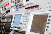 Digital and analog oscilloscope in the foreground — Stock Photo
