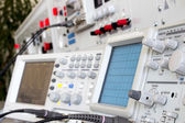 Analog and digital oscilloscope in the foreground — Stock Photo