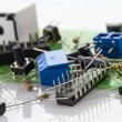 Stock Photo: Electronic components on motherboard with 10 local code lock