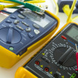 Stock Photo: Cable tester and multimeter