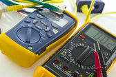 Cable tester and multimeter — Stock Photo