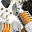 Stock Photo: New and older connectors for electrical installations