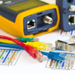 Termination of colored RJ45 cables and tester for computer netwo — Stock Photo