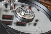 Opened HDD disc drive and reflection of laboratory panel — Stock Photo