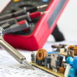 Soldering iron and 12V pulse source — Stock Photo