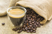 Fresh espresso and oil roasted coffee beans — Stock Photo