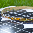 图库照片: Curled LED strip on photovoltaic solar panel