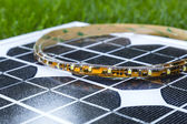 Curled LED strip on photovoltaic solar panel — Stock Photo